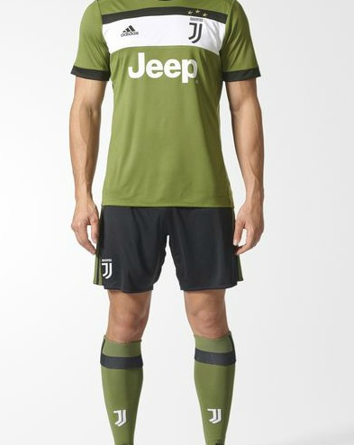 cc91b2ebb The white band is flanked by a thinner black stripe. Darker shorts and green  socks complete the look of the new Juve third strip for the 2017 18 season.